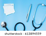stethoscope on a blue table ...   Shutterstock . vector #613894559