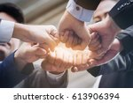 business people joining hands... | Shutterstock . vector #613906394