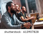 men with a beard sitting on the ... | Shutterstock . vector #613907828