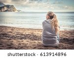 pensive lonely young woman... | Shutterstock . vector #613914896
