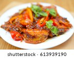 stir fried prawn with roasted... | Shutterstock . vector #613939190