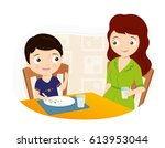boy sitting at the dinner table ... | Shutterstock .eps vector #613953044