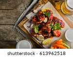 chicken wings in on wood board | Shutterstock . vector #613962518