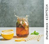 summer cold iced tea with fresh ... | Shutterstock . vector #613975214