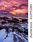 Sunset On The Sea Rocky Shore....