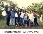diverse group of people pick up ... | Shutterstock . vector #613992593