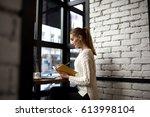 businesswoman watching online... | Shutterstock . vector #613998104