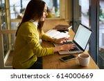 smiling attractive woman in... | Shutterstock . vector #614000669
