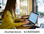 attractive female owner of web... | Shutterstock . vector #614000684