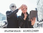 two man wearing alien masks... | Shutterstock . vector #614012489