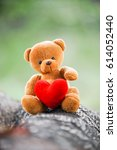 bear doll and red heart on the...   Shutterstock . vector #614052440