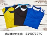 male t shirts on wooden... | Shutterstock . vector #614073740