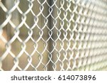 close up chain fence. metal... | Shutterstock . vector #614073896