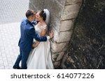 the lovely couple in love... | Shutterstock . vector #614077226
