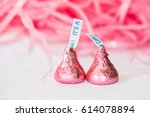 two candy kisses wrapped in... | Shutterstock . vector #614078894