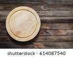 old wooden cutting board  round ... | Shutterstock . vector #614087540