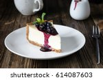 piece of cheesecake with black... | Shutterstock . vector #614087603