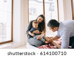 happy family with son playing... | Shutterstock . vector #614100710