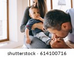 happy family with son playing... | Shutterstock . vector #614100716