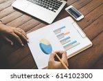 business woman analyzing graph... | Shutterstock . vector #614102300