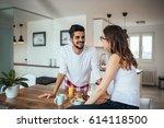 happy couple enjoying breakfast ... | Shutterstock . vector #614118500