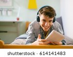 teenage boy using tablet in his ... | Shutterstock . vector #614141483
