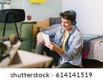 teenage boy using tablet in his ... | Shutterstock . vector #614141519
