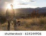 Archery hunter walking with his bow - stock photo