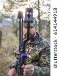 archery hunter looking down his ... | Shutterstock . vector #614144918