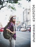 happy hipster young woman carry ... | Shutterstock . vector #614193704