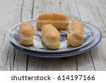 homemade mini eclairs with... | Shutterstock . vector #614197166