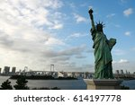 statue of liberty and rainbow... | Shutterstock . vector #614197778
