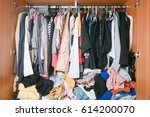 pile of messy clothes in closet.... | Shutterstock . vector #614200070