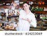 smiling girl deciding on best... | Shutterstock . vector #614213069
