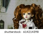 Portrait Of A Doll With...