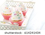 tasty cupcakes in tray on... | Shutterstock . vector #614241434