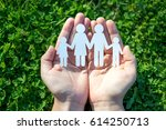 paper family in two hands on...   Shutterstock . vector #614250713