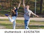 happy smiling teen couple is... | Shutterstock . vector #614256704
