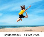 Young Sporty Girl Jumping At...