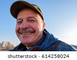 an elderly man in  baseball cap ... | Shutterstock . vector #614258024
