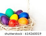 Colored Easter Eggs In A Baske...