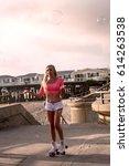 beautiful blond girl on roller... | Shutterstock . vector #614263538