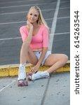 beautiful blond girl on roller... | Shutterstock . vector #614263544
