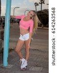 beautiful blond girl on roller... | Shutterstock . vector #614263568