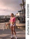 beautiful blond girl on roller... | Shutterstock . vector #614263580