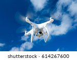 Small photo of drone flying over sea. white drone hovering in a bright blue sky. New technology in the aero photo shooting.