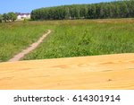 empty wooden table on nature... | Shutterstock . vector #614301914