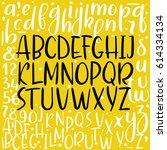 calligraphic font. handwritten... | Shutterstock .eps vector #614334134