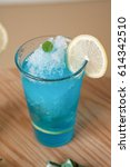 cool blue lemon ade with glass... | Shutterstock . vector #614342510