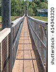 Small photo of Let's Walk Across: looking across the historic suspension bridge in Old Hanapepe Town, on Kauai, Hawaii, mid morning, on March 28, 2017